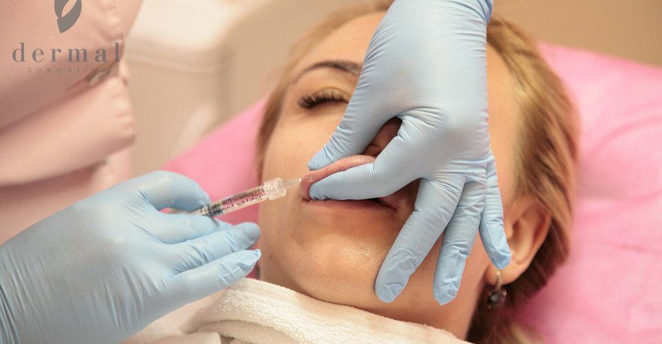 Woman getting lip filler injection
